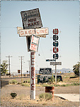 Gas station and hotel signs, now weathered and abandoned, Mina, Nev.