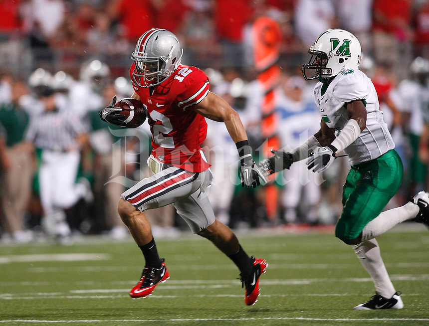 Ohio State wide receiver Dane Sanzenbacher (12) runs past Marshall cornerback Rashad Jackson (5) for a touchdown in the first quarter of the NCAA football game at Ohio Stadium on Thursday, September 2, 2010. (Photo by Jonathan Quilter)