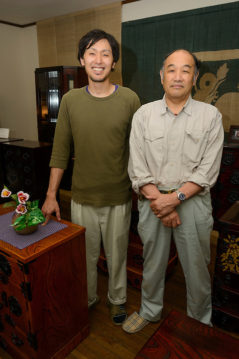 President Kenetsu Mishina and his son Ryoichiro Mishina in the showroom of Iwayado Tansu Seisakujo, Oshu City, Iwate Prefecture, Japan, July 18, 2013. Iwayado Tansu chests of drawers have been made in the city of Oshu since the 1780s. They are noted for their fine lacquer finish and finely-wrought metalwork fittings.