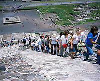 """Tourists climb up the piramid of the sun in teotihuacan, mexico 2004. Exhibited in the Salon Malafama as part of the """"Vacaciones"""" series, Mexico City July, 2006"""