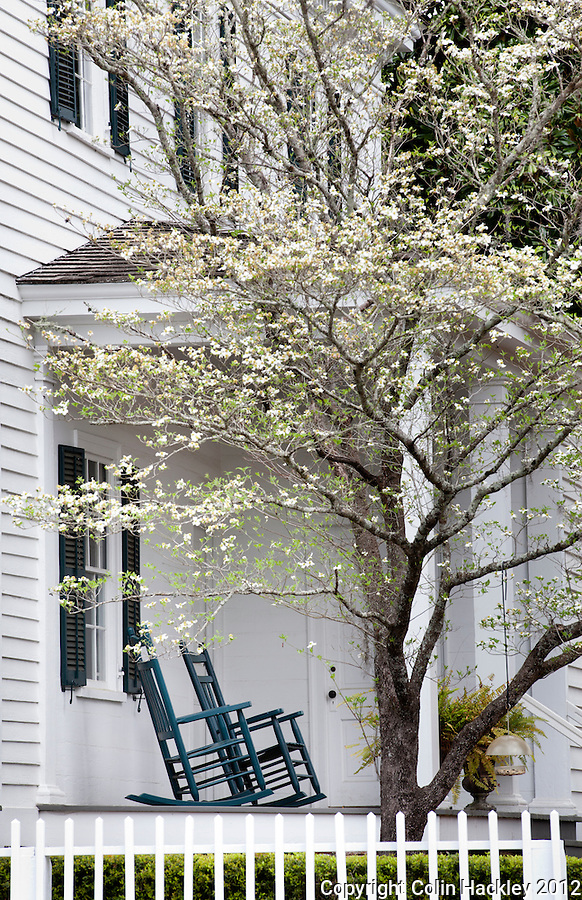 BENEATH THE DOGWOODS: Rockers repose on the side porch of the Wirick-Simmons House on Jefferson Street. Built by a circuit-riding Methodist minister in 1833, the home may be toured with advanced scheduling..SOURCE: Historic Jefferson County Walking Tour Brochure.COLIN HACKLEY PHOTO
