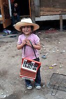 Roma 10  Maggio 2008.Rom's camp Casilino 900.Roma  Bosnian child with the accordion.Bambina rom bosniaco con la fisarmonica