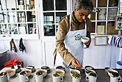 Rajah Banerjee, the owner of Makaibari Tea Estate, tastes and inhales the aroma of various types of teas at the Makaibari Tea estate, in Darjeeling, India