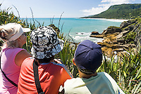Tourists enjoying views of rugged coastline in Punakaiki, Paparoa National Park, West Coast, Buller Region, New Zealand
