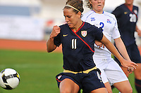 Lauren Cheney fends off defender Sif Atladottir of Iceland.  The USWNT defeated Iceland (2-0) at Vila Real Sto. Antonio in their opener of the 2010 Algarve Cup on February 24, 2010..