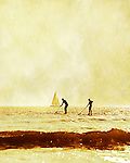 Stand-up paddle boarders (SUP) in action at Compton Bay, Isle of Wight, on a gloriously sunny and warm spring evening.<br />