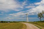 Wood frame windmill on a hilltop in Iowa.
