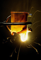 LITHIUM BURNING THROUGH BEAKER<br /> Lithium is Highly Reactive in Oxygen<br /> When exposed to water or water vapor, lithium, an alkali metal, reacts explosively with oxygen. The extreme heat from the exothermic reaction melts the glass beaker.