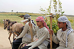 Palestinians dressed up as farmers rally as they mark Land Day in Beit Hanun in the northern Gaza Strip close to the border with Israel on March 31, 2013. The annual demonstrations mark the deaths of six Arab Israeli protesters at the hands of Israeli police and troops during mass protests in 1976 against plans to confiscate Arab land in the northern Galilee region. Photo by Ashraf Amra