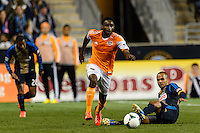 Warren Creavalle (5) of the Houston Dynamo gets past Fabio Alves (Fabinho) (33) of the Philadelphia Union. The Houston Dynamo defeated the Philadelphia Union 1-0 during a Major League Soccer (MLS) match at PPL Park in Chester, PA, on September 14, 2013.