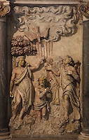High relief of the baptism of Christ by St John the Baptist, from the Altarpiece of the 3 baptisms, 1610, attributed to Nicolas Jacques, in the Basilique Saint Remi or Abbey of St Remi, Reims, France. The 11th century, mainly Romanesque, church, contains the relics of St Remi, the Bishop of Reims, who converted Clovis, the King of the Franks, to Christianity in 496 AD. The abbey is a UNESCO World Heritage Site. Picture by Manuel Cohen