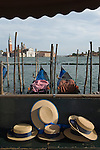Venice Italy 2009. Gondoliers traditional straw sun hats. The church of San Giorgio Maggiore  from Saint Marks Square Piazza San Marco.