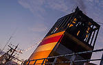A colorful PELNI ship smoke stack against an evening sky.