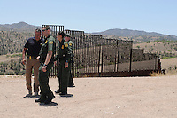 Nogales, Arizona - Four U.S. Customs Border Protection (CBP) officers prepare to leave an area near the U.S.-Mexico border where they transported reporters to during a two-day event organized by the Tucson Sector Border Patrol. The event brought national and international journalists to the Arizona border to become acquainted with the dynamics of this area. Photo by Eduardo Barraza © 2012