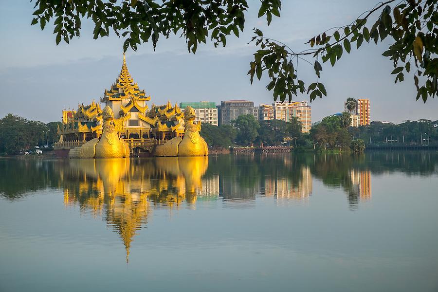YANGON, MYANMAR - CIRCA DECEMBER 2013: View of the Karaweik Hall at Kandawgyi Lake in Yangon.