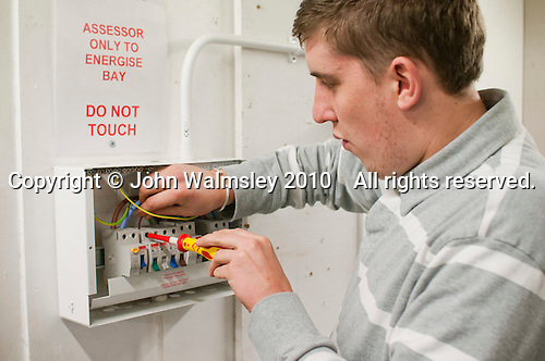 Student electrician installing a fusebox, Able Skills, Dartford, Kent.