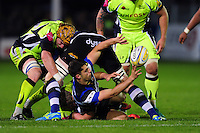 Adam Hastings of Bath Rugby offloads the ball after being tackled to ground. Aviva Premiership match, between Bath Rugby and Sale Sharks on October 7, 2016 at the Recreation Ground in Bath, England. Photo by: Patrick Khachfe / Onside Images