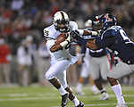 Vanderbilt running back Brian Kimbrow (25) is tackled by Ole Miss linebacker Mike Marry (52) at Vaught-Hemingway Stadium in Oxford, Miss. on Saturday, November 10, 2012. (AP Photo/Oxford Eagle, Bruce Newman)
