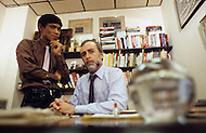 """New York, U.S.A, November 28, 1984. From left to right Dith Pran, Cambodian photojournalist and Sydney Schanberg, American Pulitzer prize journalist in their New York Times office. Dith Pran's story of escaping the Khmer Rouge regime inspired the making of the film """"The Killing Fields""""."""