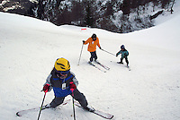 Switzerland. State of Ticino. Airolo. A mother and her children are skiing on the Peschün ski resort. Model released. © 2005 Didier Ruef