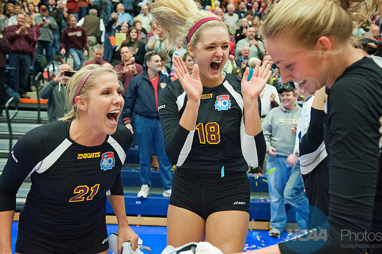 23 NOV 2013:  Calvin College's Ellie Diepersloot, left, and Emily Crowe celebrate with their teammates after defeating California Lutheran University in the Division III Women's Volleyball Championship held at the Devos Fieldhouse in Holland, MI.  Calvin defeated California Lutheran 3-2 for the national title.  Erik Holladay/NCAA Photos