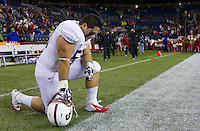 SEATTLE, WA - September 28, 2013: Stanford defensive tackle David Parry kneels before a game against Washington State at CenturyLink Field.