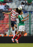 MEXICO CITY, MEXICO - AUGUST 15, 2012:  Jose Francisco Torres (16) of the USA MNT goes for a header with Manuel Viniegra (6) of  Mexico during an international friendly match at Azteca Stadium, in Mexico City, Mexico on August 15. USA won 1-0.