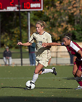 Boston College forward Kristen Mewis (19) dribbles as Florida State defender/midfielder Ines Jaurena (2) defends. Florida State University defeated Boston College, 1-0, at Newton Soccer Field, Newton, MA on October 31, 2010.