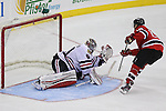 Mar 27; Newark, NJ, USA; New Jersey Devils center Travis Zajac (19) scores the game winning goal on Chicago Blackhawks goalie Corey Crawford (50) during the overtime shootout at the Prudential Center. The Devils defeated the Blackhawks 2-1.