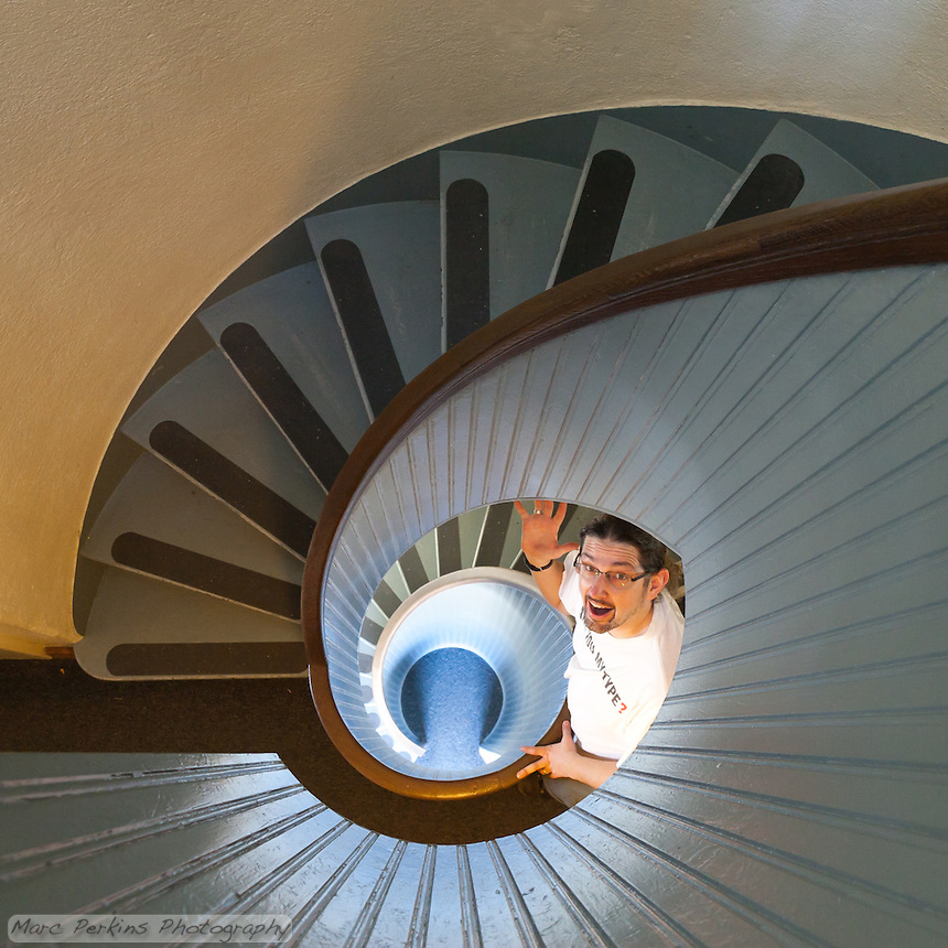 I'm standing on the second level of the stairway to the top of the Old Point Loma Lighthouse in Cabrillo National Monument, waving up at the camera.  Greg (of Alpenglow Images Photography) is nicely pressing the trigger of my tripod-mounted camera.