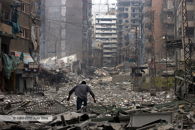 Lebanon: Beirut: July 20, 2006: A Lebanese man moves through rubble in the Bir al-Abed district that was destroyed by Israeli air strikes in the southern suburbs of Beirut, during a tour organized by the information office of Hezbollah.