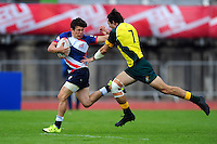 Christopher Levesley of Great Britain fends Liam McNamara of Australia. FISU World University Championship Rugby Sevens Men's Cup Final between Australia and Great Britain on July 9, 2016 at the Swansea University International Sports Village in Swansea, Wales. Photo by: Patrick Khachfe / Onside Images