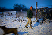 Donovan Nokes plays with his bird dogs, which he uses for hunting pheasants, on Monday, December 5, 2011 in Webster City, IA.