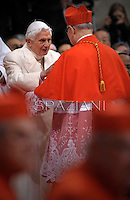Spanish cardinal Fernando Sebastian Aguilar   is congratulated by Pope emeritus Benedict XVI  after he was appointed cardinal by the Pope at the consistory in the St. Peter's Basilica at the Vatican on February 22, 2014.