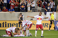 Luke Rodgers (9) of the New York Red Bulls celebrates scoring with teammates. The New York Red Bulls defeated the Portland Timbers 2-0 during a Major League Soccer (MLS) match at Red Bull Arena in Harrison, NJ, on September 24, 2011.
