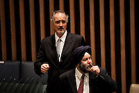 Syrian Ambassador to the United Nations Bashar Jaafari (L) leave the security council at the UN headquarter in New York, July 19, 2012.  UN Security Council vetoed a resolution that would impose sanctions against Syria's President Bashar al-Assad if he does not end the use of heavy weapons.  as members of the 15-nation council to block resolutions on Syria. Photo by Eduardo Munoz Alvarez / VIEW.