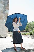 Nadja Massun, a photographer living in Oaxaca takes a photo at the etno-botanical gardens. Santo Domingo,  Oaxaca City, Oaxaca, Mexico