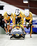 22 November 2009:  Ivo Rueegg, piloting the Switzerland 1 bobsled, leads his 4-man team to a 4th place finish at the FIBT World Cup competition, in Lake Placid, New York, USA. Mandatory Credit: Ed Wolfstein Photo