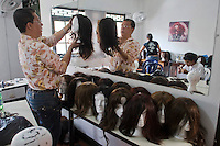 People work with wigs for cancer patients before being donated as a commitment to actively fight against cancer in Medellin, Colombia, May 25, 2012.  Colombia celebrated on 31 January, 7, 14 and 21 February some days of donating hair in Beauty Centres Fundayama ALQVIMIA and foundation (Foundation for support and support people with breast cancer), it received 300 donations of hair with which they made 200 wigs  Photo by Fredy Amariles/View