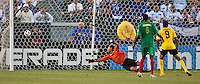 CARSON, CA – June 6, 2011: Greneda goalie Shemel Louison (30) attempts to stop a goal during the match between Grenada and Jamaica at the Home Depot Center in Carson, California. Final score Jamaica 4 and Grenada 0.