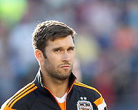 Houston Dynamo forward Will Bruin (12). In a Major League Soccer (MLS) match, the New England Revolution (blue/white) defeated Houston Dynamo (orange), 2-0, at Gillette Stadium on April 12, 2014.