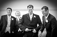 A groom and his groomsmen share a laugh while they smoke cigarettes during a break from wedding obligations. (Photo by Scott Eklund/Red Box Pictures)