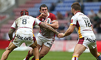 Wigan Warriors' Ben Flower is tackled by Huddersfield Giants' Sam Rapira (left) and Paul Clough(right) <br /> <br /> Photographer Stephen White/CameraSport<br /> <br /> Betfred Super League Round 5 - Wigan Warriors v Huddersfield Giants - Sunday 19th March 2017 - DW Stadium - Wigan<br /> <br /> World Copyright &copy; 2017 CameraSport. All rights reserved. 43 Linden Ave. Countesthorpe. Leicester. England. LE8 5PG - Tel: +44 (0) 116 277 4147 - admin@camerasport.com - www.camerasport.com
