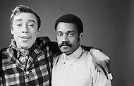 """June 1969 --- Godfrey Cambridge, a black actor, plays a white man turned into a black man, in Melvin Van Peebles' (right) 1970 comedy Watermelon Man. Some of the """"white"""" makeup Cambridge is wearing can be clearly seen only partly covering his hand around Van Peebles' shoulder. --- Image by © JP Laffont"""