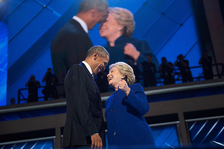UNITED STATES - JULY 27: President Barrack Obama and Democratic nominee Hillary Clinton meet on stage at the Wells Fargo Center in Philadelphia, Pa., on the third day of the Democratic National Convention, July 27, 2016. (Photo By Tom Williams/CQ Roll Call)