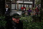 Spectators observe from a gated area as anti-GOP protesters march through the streets during the 2012 Republican National Convention on August 27, 2012 in Tampa, Fla.