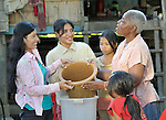 Irene Mparutsa, right, a United Methodist missionary, discusses the proper use of a water filter with women in the Cambodian village of Talom. Mparutsa works with the Community Health and Agricultural Development program of the Methodist Mission in Cambodia.