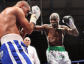 Ajose Olusegun (white/green shorts, Finchley) defeats Mahaita Mutu (Strasbourg, blue shorts) in a Light-Welterweight contest at Goresbrook Leisure Centre, Dagenham, Essex promoted by Frank Maloney / FTM Sports - 18/07/08 - MANDATORY CREDIT: Gavin Ellis/TGSPHOTO - Self billing applies where appropriate - Tel: 0845 094 6026.