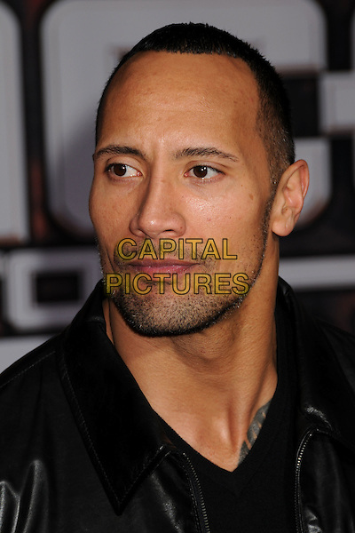 """DWAYNE """"THE ROCK"""" JOHNSON.""""Race to Witch Mountain"""" Los Angeles Premiere at the El Capitan Theatre, Hollywood, California, USA..March 11th, 2009.headshot portrait black stubble facial hair .CAP/ADM/BP.©Byron Purvis/AdMedia/Capital Pictures."""