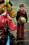 Kows for Kids workers moved 108 completed cows from a warehouse on NW 14th to the Pacific Northwest College of Art building on NW Johnson.  Moss Hardman, 5, was on an outing with his grandparents and happened to be in cowboy gear , and not knowing about the herd, was a bit overcome..